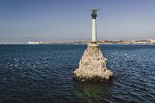 pic of historical ship  - Monument to the Scuttled Ships in the afternoon on a background of blue sky - JPG