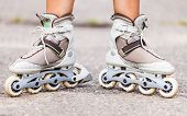 image of inline skating  - Enjoying roller skating rollerblading on inline skates sport in park - JPG