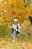 stock photo of lady boots  - Beautiful cute girl in white boots on a daily walk in the park - JPG