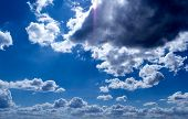 foto of cumulus-clouds  - The rays of the Sun - JPG