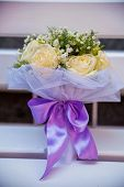 picture of rose close up  - beautiful tender bridal bouquet with roses on a wooden bench close up - JPG