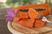 picture of pawpaw  - Ripe papaya cut into pieces with natural light - JPG