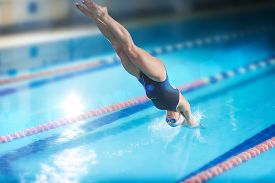picture of jumping  - Portrait of a female swimmer - JPG
