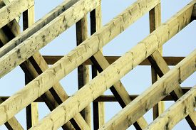 stock photo of rafters  - Wooden rafters on top of new house - JPG