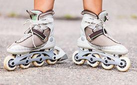 pic of inline skating  - Enjoying roller skating rollerblading on inline skates sport in park - JPG