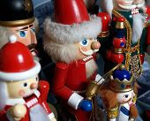 pic of tchaikovsky  - a closeup of a santa claus nutcracker surrounded by other brightly colored toys - JPG