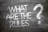 What Are The Rules? written on a chalkboard poster
