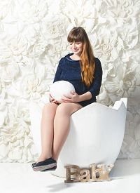 picture of human egg  - Conceptual shot of beautiful pregnant woman posing with big egg at studio - JPG