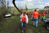 SAINT LOUIS, MISSOURI - APRIL 22:  Volunteers with Service International help residents of St. Louis