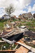 SAINT LOUIS, MISSOURI - APRIL 22: Debris from destroyed homes and property is strewn across areas of
