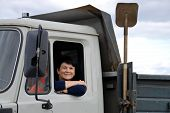 woman behind the wheel of a truck