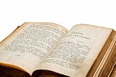 Antique open book on white background. Old Testament.