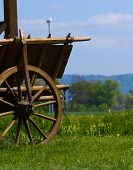 stock photo of 1700s  - old cart wheel transportation farm vehicle historical equipment - JPG