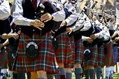 stock photo of bagpiper  - Bagpipe players in line at a parade - JPG