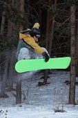 Flying Snowboarder On Green Board