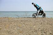 Empty Pushchair On Beach