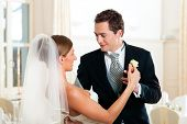 picture of wedding feast  - Bride and groom dancing the first dance at their wedding day - JPG