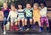 Group of kindergarten kids friends arm around sitting and smiling fun poster