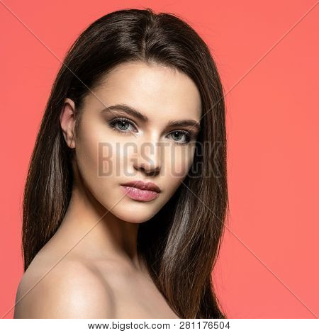 poster of Woman with beauty long brown hair. Fashion model with long straight hair. Fashion model posing at st