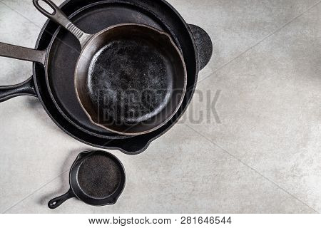Several Cast Iron Pans Or