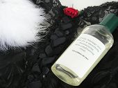 image of massage oil  - lingerie with feather and massage oil - JPG