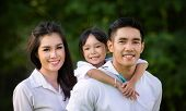 Asian Smile Family In Park, This Immage Can Use For Asia, Asian, Thai, Father, Mother, Kid, Daughter poster