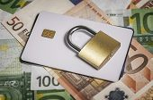 Security Lock On Credit Cards And Euro Banknotes, Close Up. Credit Card Data Encryption For Security poster