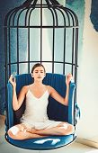 Meditative And Tranquil. Cute Woman Concentrate And Meditate In Chair. Woman Relax In Lotus Position poster