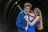 young couple dressed for prom or party posing sensually poster