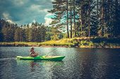 Caucasian Men In His 30s Fishing From A Kayak. Lake Recreation Time. poster