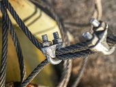 The End Knot Of Steel Rope. Stainless Steel Turnbuckle And Sling Steel In Base. Detail Of Steel Bolt poster