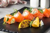 Salmon Rolls Stuffed With Cream Cheese And Herbs, Beautiful Snack, Elegant Food For Menu poster