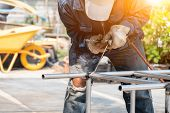 The Welder Is Welding The Steel Frame. Labor And Industrial Work Hard. poster