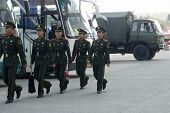 NANJING, CHINA - NOVEMBER 24: Soldiers on cleaning duty march to clean the Nanjing bridge office bef