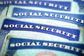 Social Security Cards Symbolizing Benefits for Elderly United Stated poster