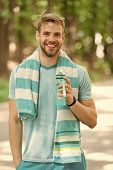 Man With Athletic Appearance Holds Bottle With Water. Sport And Healthy Lifestyle Concept. Man Athle poster