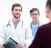 doctors congratulating the patients recovery poster