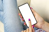 Smartphone Mockup In Woman Hand. New Modern Black Frameless Smartphone Mock Up With Blank White Scre poster