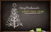 Blackboard with Christmas tree and New Year's greeting
