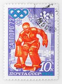 SOVIET UNION - CIRCA 1972: A stamp printed in USSR shows a ice-hockey goalkeeper (gold medal) Vladis