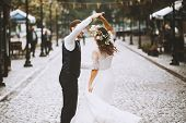 Newlywed Couple Dancing In The Street, Happy Emotional Bride Dancing Outdoors With Elegant Groom poster