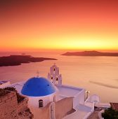 Blue dome Church St. Spirou in Firostefani on the island of Santorini Greece, at sunset