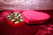 Engagement Ring. Wedding Ring or Engagement Ring with Chocolates in a Red Velvet Valentines Day Hear poster