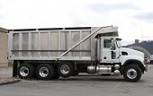 stock photo of dump_truck  - brand new clean dump truck at truck dealer lot - JPG