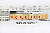 picture of scrabble  - Schedule abstract with bar chart and wooden scrabble - JPG