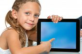 Close Up Of Cute Girl Pointing On Blank Tablet Screen.