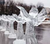 Carved sculpture of frozen angel in ice