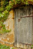 Door Into The Garden Into Medieval Castle In England In Summer Day poster
