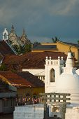stock photo of coexist  - A temple and church that shows christian and buddhist religions coexisting peacefully in Galle Sri Lanka - JPG