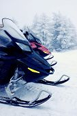 Two snowmobiles in the mountains